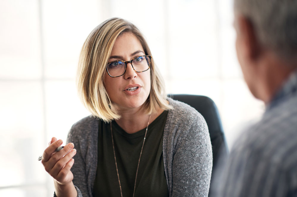 Woman in meeting with colleague