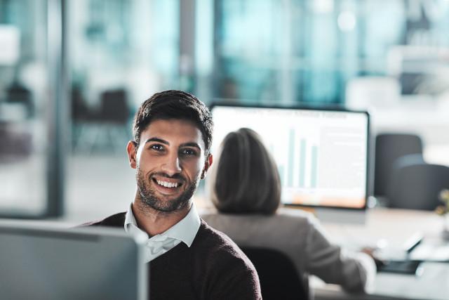 Smiling man sitting at desk