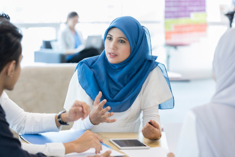 Woman in meeting with colleagues